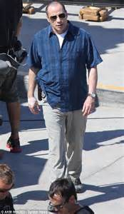 Look who's balding! John Travolta ditches the weave and